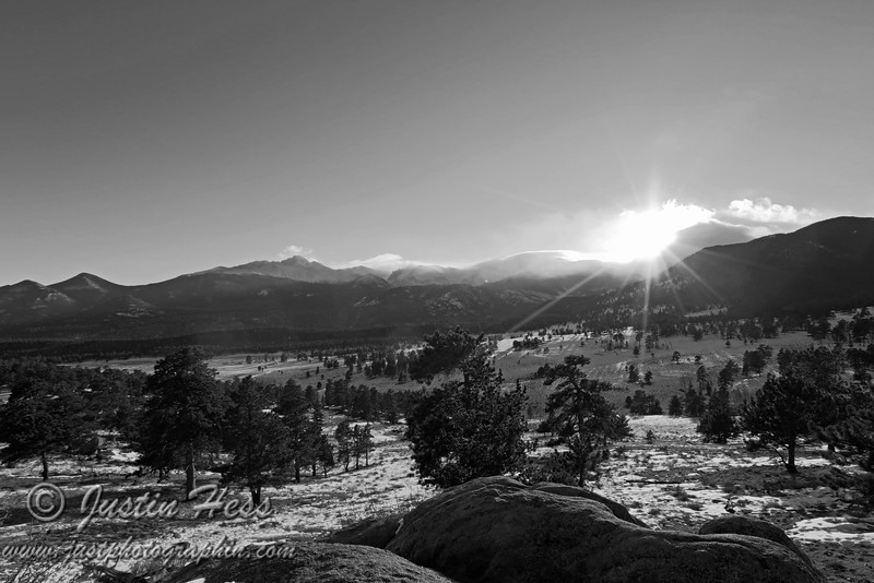 Taken from the Beaver Meadows Overlook, just below Deer Ridge Junction.  The sun is getting closer to setting, yet it added nice effect on the snow and clouds rolling over the Continental Divide.