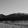 Longs Peak with another cloud passing over head.