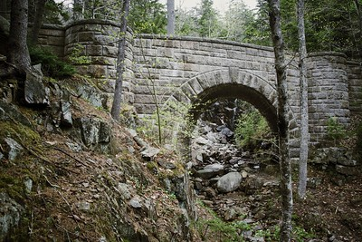 Stone arch bridge along a carriage road, with the only waterfalls in the area, almost a trickle right now
