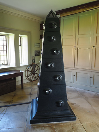 The Obelisk <br /> <br /> In the Estate Office a black structure sits in the centre of the room. Eyes within the surface invite the onlooker to peer inside and observe the secrets within. Small items, which in normal circumstances are easily overlooked, are housed within their own vitrines