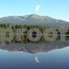 Magnificant  view of Mount Katahdin's Baxter Peak  from the Katahdin Unit of Camp Natarswi, the Girl Scout Camp located on Lower Togue Pond.  With the the end of Appalachian Trail and Mount Katahdin at your doorstep, Natarswi offers a true, north woods camping experience.  Elevation 5,268 feet.