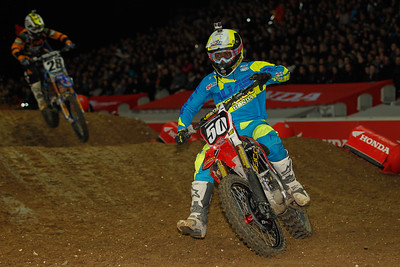 Malcolm Stewart crashes and starts again in front of Peick who leads