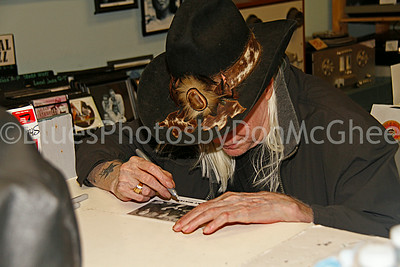 Johnny Winter signing autographs