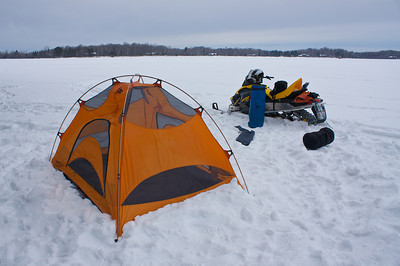 Packing up... after a night camping... out on the ice.... my new tent...its first night....