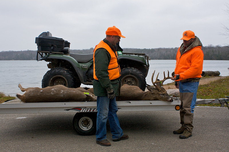 Successful deer hunters at Boulder Lake in the Nicolet.