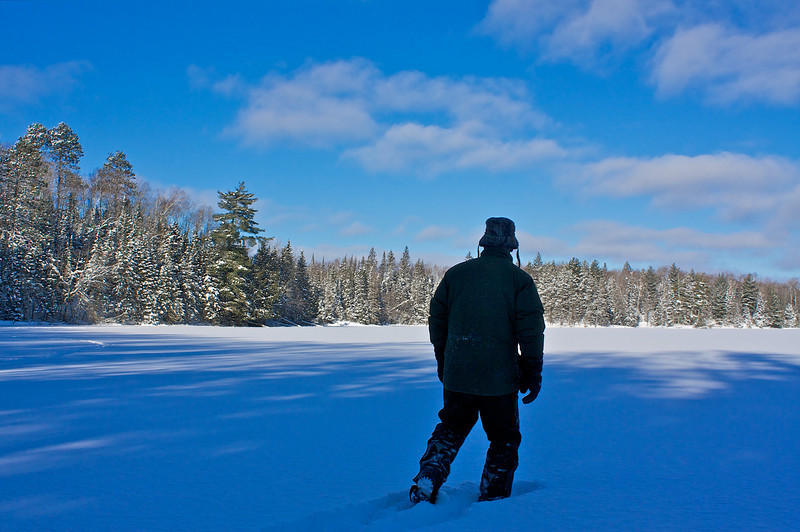 Snowshoeing on Rock Lake at sunrise at below zero F. To get here I took off by snowmobile at first light..with snowshoes strapped on. I parked the sled on the side of the snowmobile trail then worked my way in on the shoes. This is a non motorized area.
