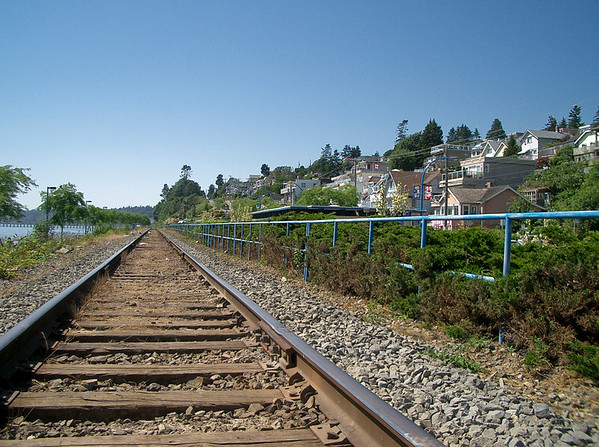 The train tracks running north from the USA through the backyards of White Rock, British Columbia  ©Gerald Diamond All rights reserved