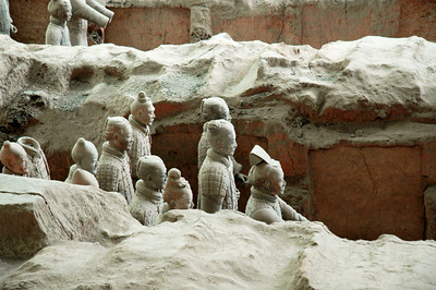 Warriors Marching Out Of The Past - These terra cotta clay warriors had lain buried for hundreds of years before discovered in 1952 by a farmer.  Now many thousands have been uncovered, remarkably each with a different face.  Xian, China  ©Gerald Diamond All rights reserved