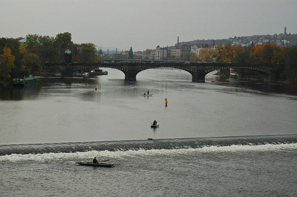 In Prague, the Vltava River in a cool rain in October is the perfect spot for a few persistent fishermen.  ©Gerald Diamond All rights reserved