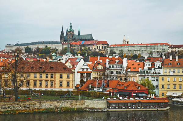 """Prague's """"Little Quarter"""" on a dull and drizzly October afternoon - from Charles Bridge.  Atop the hill sits Prague Castle, completely covering the horizon and crowned by St. Vitus Cathedral. Prague, Czech Republic  ©Gerald Diamond All rights reserved"""