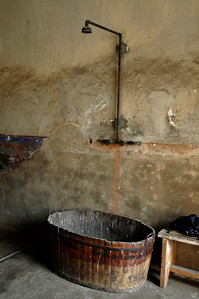Camp occupants were rarely allowed to clean themselves.  This lone shower outside a cell cannot be understood.  ©Gerald Diamond All rights reserved