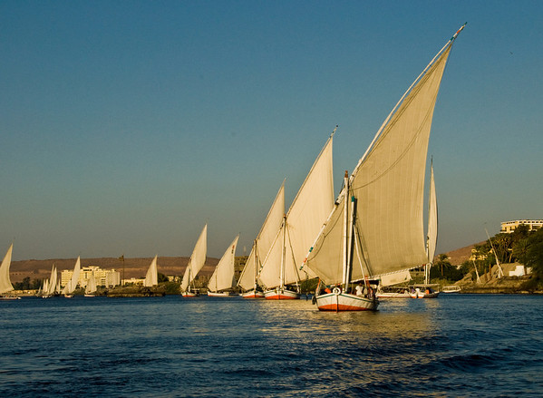 Faluccas take to the Nile at sunset for a breathtaking sail near Luxor, Egypt.  ©Gerald Diamond All rights reserved