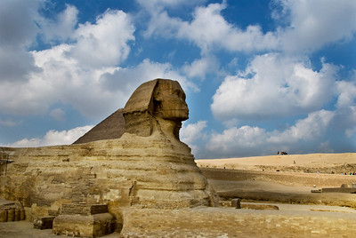 The Sphinx lies peacefully guarding the Pyramids at Giza.  ©Gerald Diamond All rights reserved
