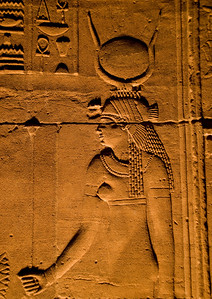 Isis, the mother of Horus and wife of Osiris, here depicted as she often is with the hieroglyphic symbol for a crown.  ©Gerald Diamond All rights reserved