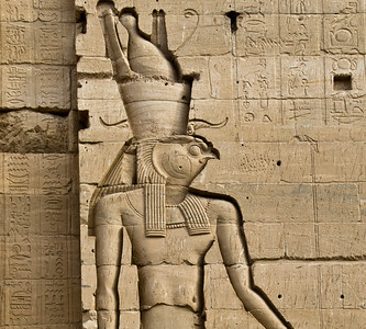 This spectacularly well-preserved and deeply-carved image of the God Horus, symbolized by a falcon's head, stands on one of the giant entrance walls to the Temple of Philae.  Horus became synonymous with the Pharaoh.  ©Gerald Diamond All rights reserved