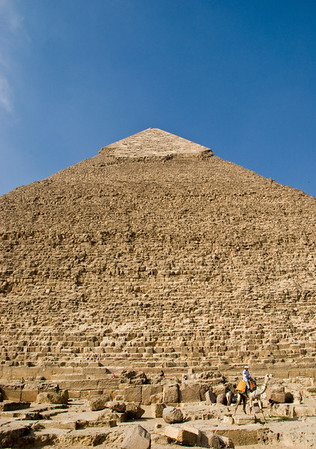 The Great Pyramid of Giza - notice the camel and rider as well as a number of people walking along the base of the Pyramid (enlarge the photo for a better look).  The camel is much farther from the base of the Pyramid than you would think.  ©Gerald Diamond All rights reserved