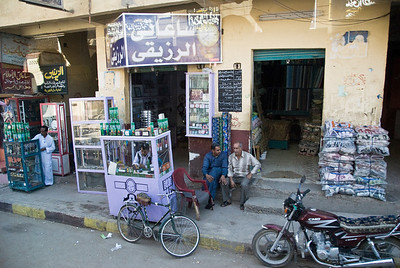 Street Scene - typical street in towns and cities of Egypt from Aswan north to Luxor.  In this photograph a number of vendors crowd closely together.  ©Gerald Diamond All rights reserved