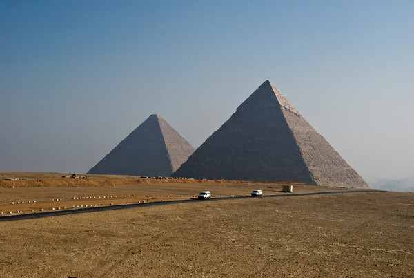 On the Giza plain two of the three Great Pyramids stand out as the magnificent tributes to the Pharaohs who commissioned their construction.  ©Gerald Diamond All rights reserved