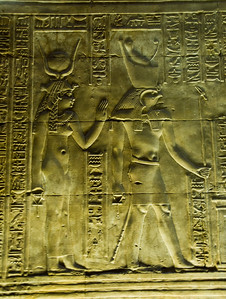 Edfu Temple walls bear the images of the gods Isis and Horus.  ©Gerald Diamond All rights reserved