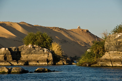 On the Nile River just south of Luxor - A small shrine to a local Luxor man sits atop a hill on the West bank of the river overlooking the city which lies across the river on the East side.  ©Gerald Diamond All rights reserved