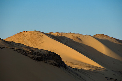 Dunes on the Eastern fringe of the Egyptian desert overlooking the Nile River.  Two men sit at sunset and contemplate...  ©Gerald Diamond All rights reserved