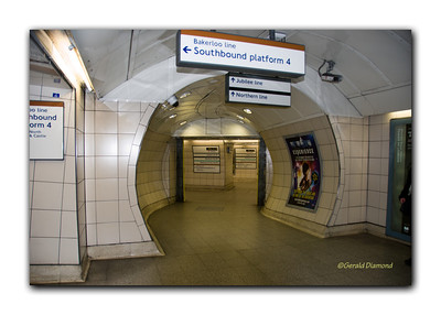 "Rare Quiet Time In The Underground:  London's famous ""tube"" moves millions of people each and every day through 275 stations.  Finding your way, for one unfamiliar with its miles of corridors and passageways, can be a challenge.  But signage is excellent even though the usual press of crowds can make the adventure a bit intimidating.  ©Gerald Diamond All rights reserved"