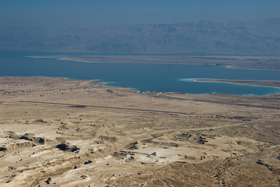 The view looking eastward from the top of Masada.  In the distance are the hills of Jordan and in between an airstrip and roadway.  Enlarge the photo for more details.  ©Gerald Diamond All rights reserved