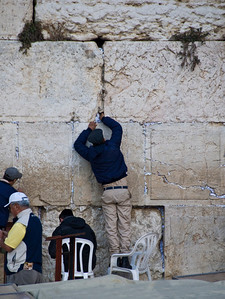 Straining to leave a message for God - Western Wall, Jerusalem  ©Gerald Diamond All rights reserved