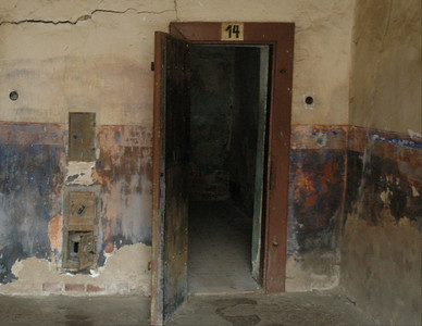Terezin's cell blocks were dismal places designed to dishearten prisoners and isolate them.  This door opens onto a dark cell with only one very high window.  ©Gerald Diamond All rights reserved