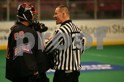 Mike Thompson discusses it with referee Mark Triniastich