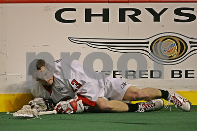 Brett Queener falls prey to a Geoff Snider 5 minute high sticking penalty - 7:11-1st  LP-09-113-01-crop copy