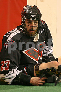 Athan Iannucci adjusts his knee brace during the pregame warmups in a valiant attempt to come back from a devastating knee injury in the Wings 2009 home opener.    LP-09-107-22-vertcrop copy