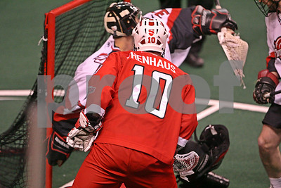 Brenden Thenhaus shoots wide of Matt Roik and the goal.    LP-09-488-06 copy