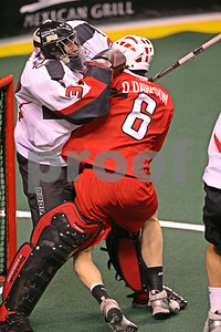 Dan Dawson collides with goal Matt Roik drawing an interference call.  Dan Dawson interference 6:07-1st  LP-09-484-07 copy