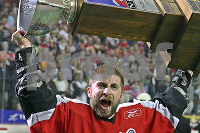 2009 NLL Champions Cup MVP Josh Sanderson hoists the Cup over his head after his Calgary Roughnecks beat the New York Titans for the Championship in Calgary, Alberta.  LP-09-1384-11-crop copy