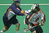 LP-10-1069-29-crop copy  Orlando Titan's defender Jeff Bigas gets a stick in the face of Mark Steenhuis of the Buffalo Bandits.
