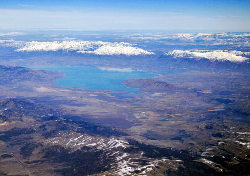 This view of the Great Salt Lake, looking northeast, was taken on a flight back to New Mexico. The next image is of the range of mountains just right of center, jutting into the lake.