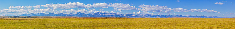 Panorama of the Rocky Mountains south of Glacier National Park, which lies at the extreme right end of the image.