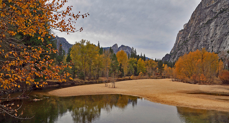 Looking West across the Merced River. In Fall, before the arrival of rains and melting snows, the river is very placid.