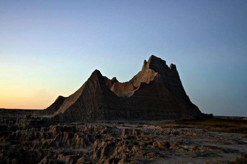 """The """"Castle"""" formation, just after sunset; Badlands, South Dakota."""