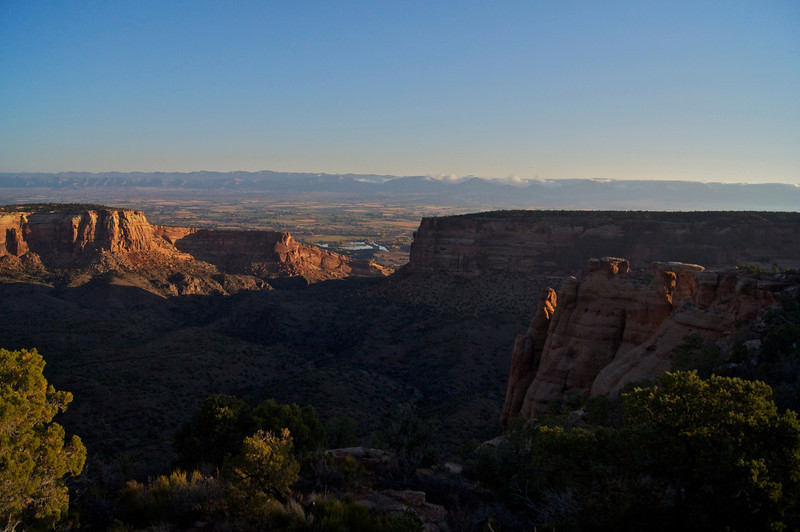 Early morning sunlight slowly fills Monument Canyon just west of Grand Junction, Colorado.