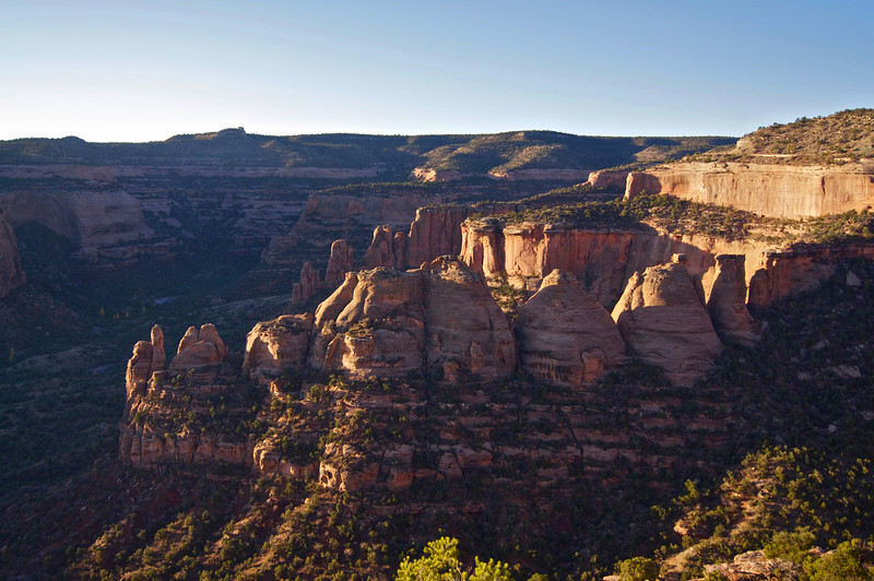 Deep morning shadows highlight the distinctive contour of the Coke Ovens formation; Colorado National Monument
