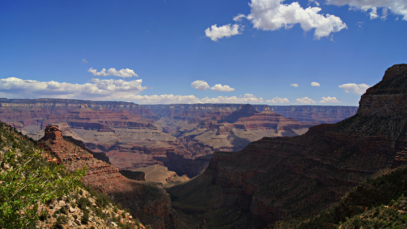 The lowering afternoon sun creates stark contrast between light and shadow; Grand Canyon, Arizona.
