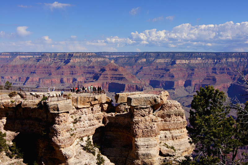 Tourists admire the Grand Canyon from a popular south rim vantage point.