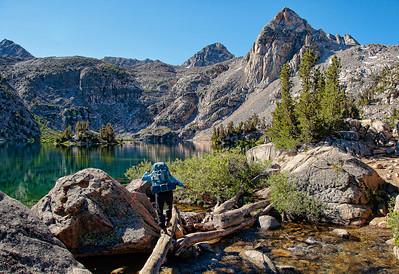 mountain-lake-hiker-creek-crossing