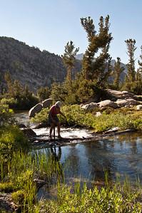 hiker-crossing-creek