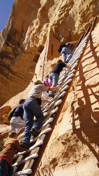 A tour group climbs the tallest ladder into the Balcony House, Mesa Verde National Park, Colorado.