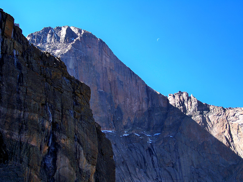 Sun, shadows and crescent moon over the Longs Peak Diamond Face; Rocky Mountain National Park