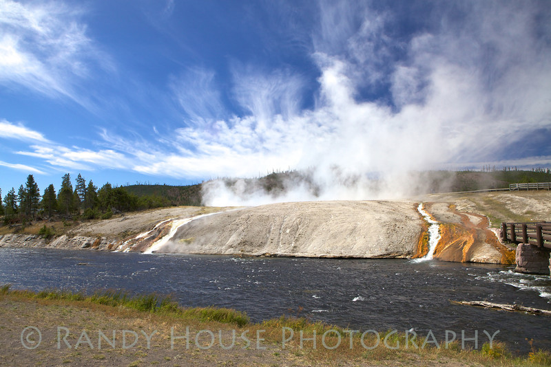 Hot water spilling into the Firehole River at Midway Geyser Basin