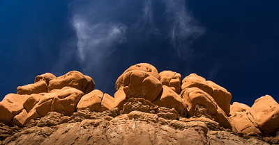 Rock formation at Goblin Valley State Park, contrasted against the clouds.